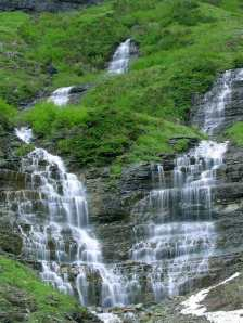 Water falling over the glacier [courtesy of PD Photo via Creative Commons]
