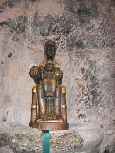 La Moreneta, Black Madonna of Montserrat, in a prayer mini-grotto niche, also at the Santa Maria Monastery in Catalonia, Spain.
