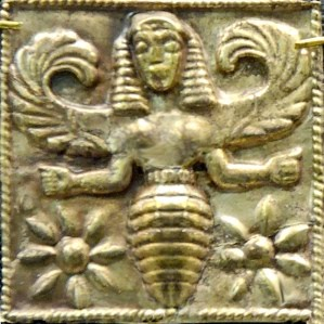 A gold plaque of the Bee Goddess, circa 7th century B.C., discovered in Camiros, Rhodes, and now residing at the British Museum.