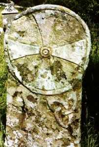 An encircled equidistant cross set above Brigid's Knots, found at Killaghtee in County Donegal, Ireland. Image from Irish Megaliths (see link below).