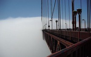 Fog meets the Golden Gate, San Francisco. By Sandiegoguy30, generously shared via Creative Commons and WikiMedia.