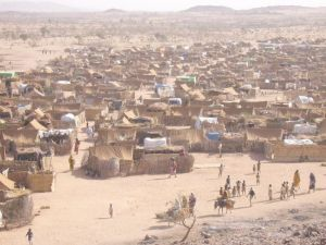 Darfur Refugee Camp in Chad, 2005, by Mark Knobil. PD-CCA via Wikimedia.