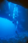 Divers descending into the main cavern of Blue Hole, Palau_Islands, Micronesia. PD image courtesy of Wikimedia.