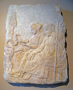 Marble relief of Asclepius and Hygieia. Therme of Salonika, classical period, last quarter of the 5th ct. BC. Istanbul Archaeological Museum inv. no. 109 T (Mendel 91). PD-US, Wikimedia.