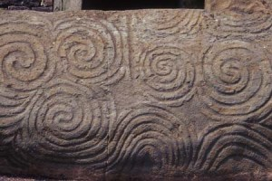 Spiral stones at the entrance to Newgrange, Ireland. GNU-Free photo via Wikimedia.